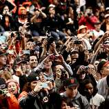 Giants fans fill the sidewalks as the San Francisco Giants celebrated their World Series Championship with a parade up Market Street in downtown San Francisco, Calif., on Wednesday Oct. 31, 2012.