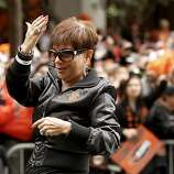 Giants' announcer Renel Brooks-Moon shoes off her Championship ring, as the San Francisco Giants celebrated their World Series Championship with a parade up Market Street in downtown San Francisco, Calif., on Wednesday Oct. 31, 2012.