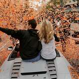 Giants' catcher Buster Posey and his wife Kristen pass through a stream of confetti as the San Francisco Giants celebrated their World series Championship with a parade up Market Street in downtown San Francisco, Calif., on Wednesday Oct. 31, 2012.