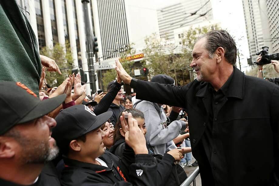 Giants manager Bruce Bochy gives high-fives to fans before the World Series victory parade on Wednesday, October 31, 2012 in San Francisco, Calif. Photo: Beck Diefenbach, Special To The Chronicle