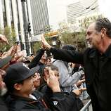 Giants manager Bruce Bochy gives high-fives to fans before the World Series victory parade on Wednesday, October 31, 2012 in San Francisco, Calif.