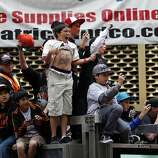 Fans cheer the Giants players during the World Series victory parade on Wednesday, October 31, 2012 in San Francisco, Calif.