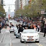 Giants shortstop Brandon Crawford and his wife Jalynne Dantzscher wave to the crowd during the World Series victory parade on Wednesday, October 31, 2012 in San Francisco, Calif.