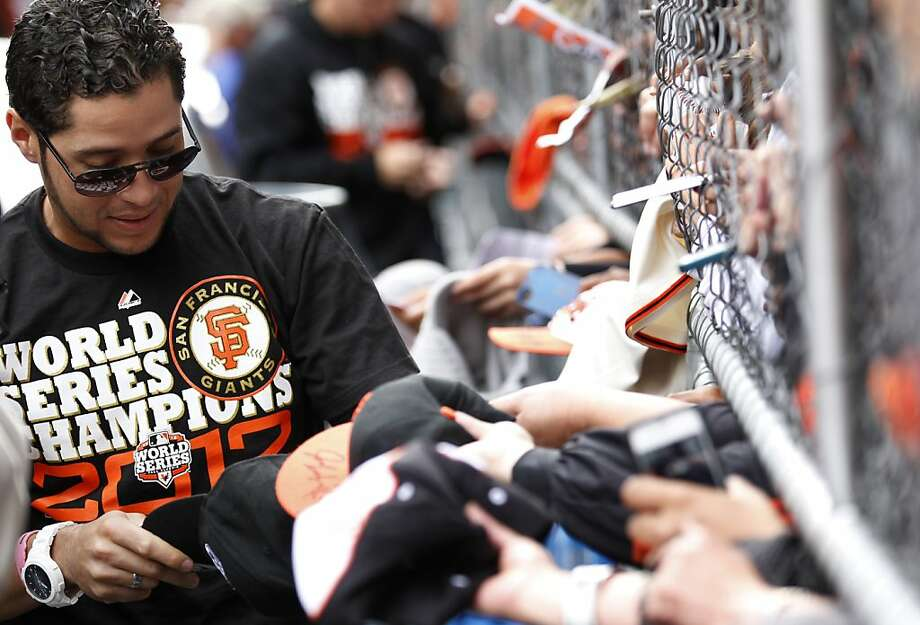 Giants left fielder Gregor Blanco signs autographs for fans before the World Series victory parade on Wednesday, October 31, 2012 in San Francisco, Calif. Photo: Beck Diefenbach, Special To The Chronicle