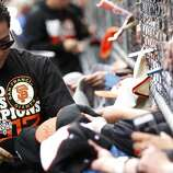 Giants left fielder Gregor Blanco signs autographs for fans before the World Series victory parade on Wednesday, October 31, 2012 in San Francisco, Calif.
