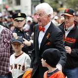 Former managing general partner for the Giants, Bill Neukom address fans before the World Series victory parade on Wednesday, October 31, 2012 in San Francisco, Calif.