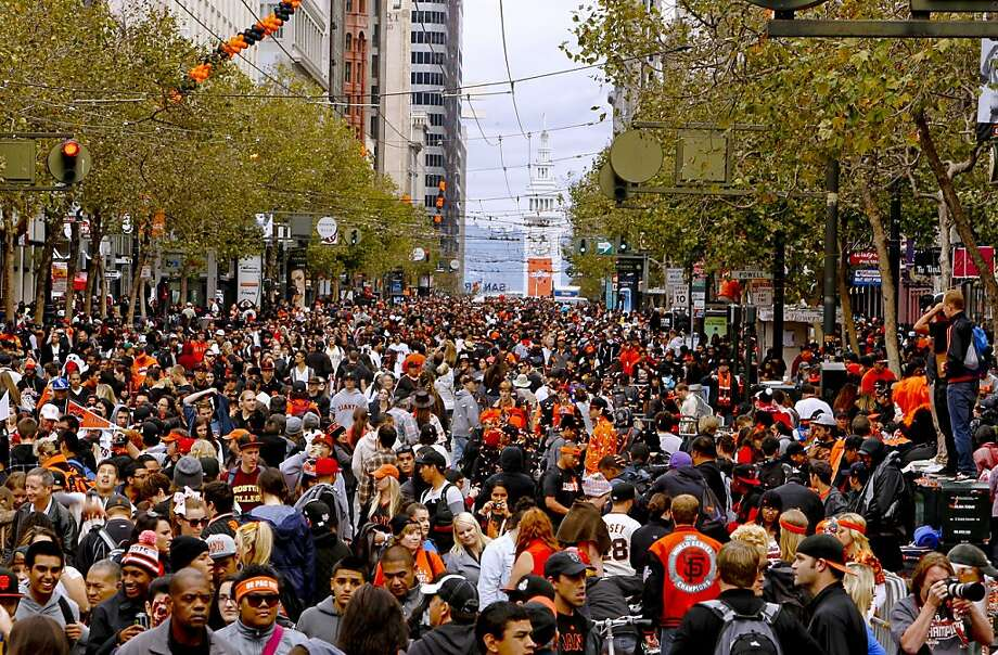 Fans followed the end of the parade up Market Street to join the crowds at Civic center as the San Francisco Giants celebrated their World Series Championship with a parade up Market Street in downtown San Francisco, Calif., on Wednesday Oct. 31, 2012. Photo: Michael Macor, The Chronicle