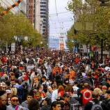 Fans followed the end of the parade up Market Street to join the crowds at Civic center as the San Francisco Giants celebrated their World Series Championship with a parade up Market Street in downtown San Francisco, Calif., on Wednesday Oct. 31, 2012.