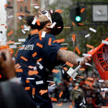 Sergio Romo posed for the crowd as the confetti came down on Market Street. The San Francisco Giants celebrated their second World Series title in three years with a parade down Market Street Wednesday October 31, 2012.