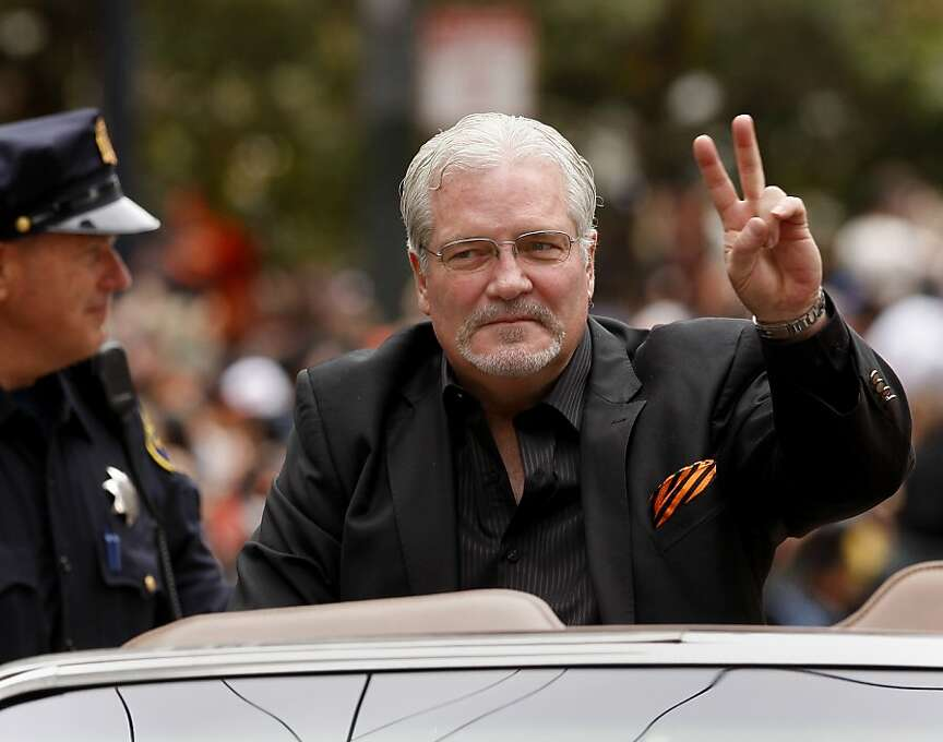 General manager Brian Sabean greeted the fans with a two World Series victory sign. The San Francisco Giants celebrated their second World Series title in three years with a parade down Market Street Wednesday October 31, 2012. Photo: Brant Ward, The Chronicle