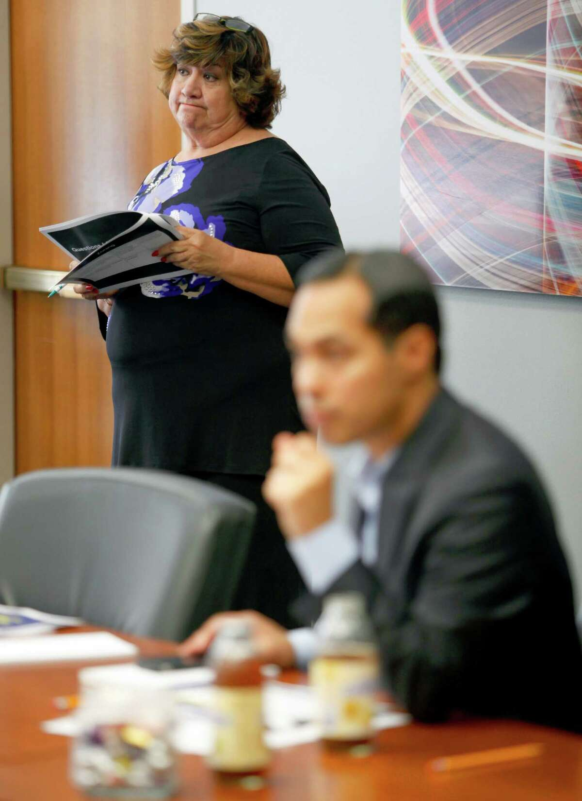 Connie Salinas, president of San Antonio Residential Care Homes organization, listens as city council is presented Wednesday Oct. 31, 2012 during a B Session meeting with more information about a proposed ordinance that would allow the city to regulate an estimated 200 boarding homes in San Antonio.