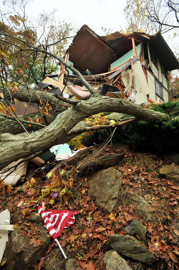 The Lopez home in Danbury sustained damage due to a large tree falling on it Monday evening because of storm Sandy. Photographed on Wednesday, Oct. 31, 2012. Photo: Jason Rearick, Connecticut Post / The News-Times