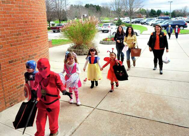 Children enter Brookfield Hall for Halloween candy Wednesday, Oct. 31, 2012. Photo: Michael Duffy, Connecticut Post / The News-Times