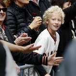 Ari Ephstein of El Sobrante watched the parade with his parents. The San Francisco Giants celebrated their second World Series title in three years with a parade down Market Street Wednesday October 31, 2012.