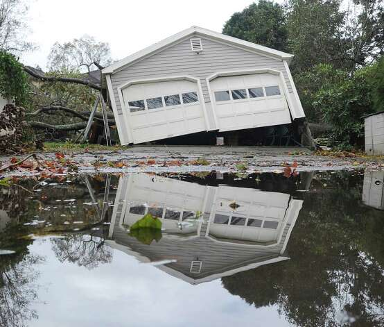 A garage off its foundation on Binney Lane during the aftermath of Hurricane Sandy in Old Greenwich, Tuesday, Oct. 30, 2012. Photo: Bob Luckey, Connecticut Post / Greenwich Time
