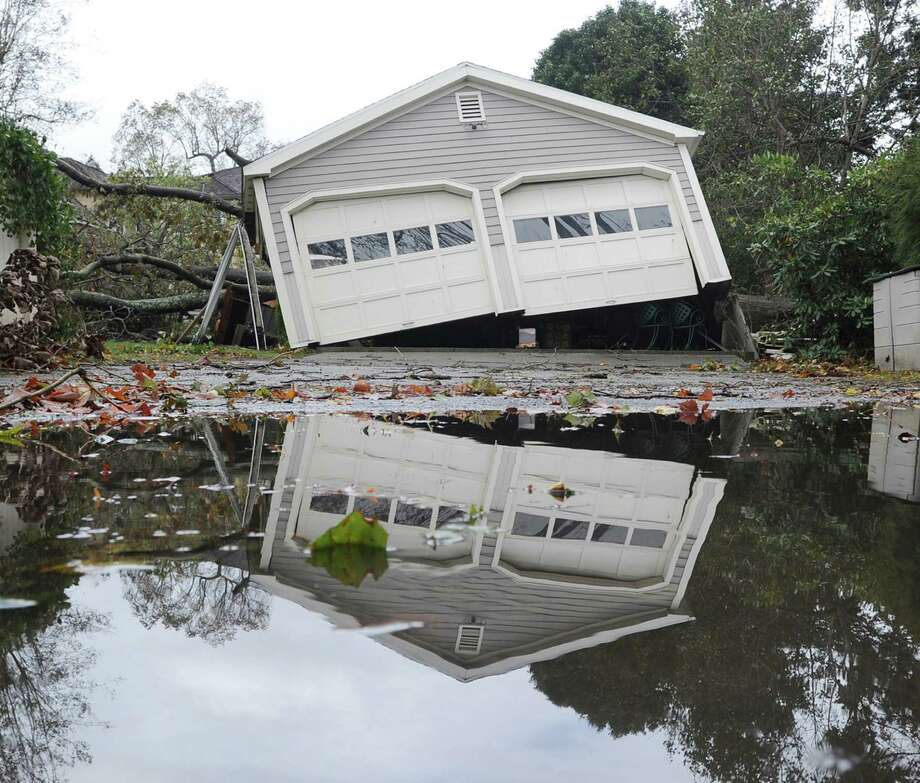 A garage off its foundation on Binney Lane during the aftermath of Hurricane Sandy in Old Greenwich, Tuesday, Oct. 30, 2012. Click through for more scenes from Superstorm Sandy's path through Connecticut. Photo: Bob Luckey, Connecticut Post / Greenwich Time