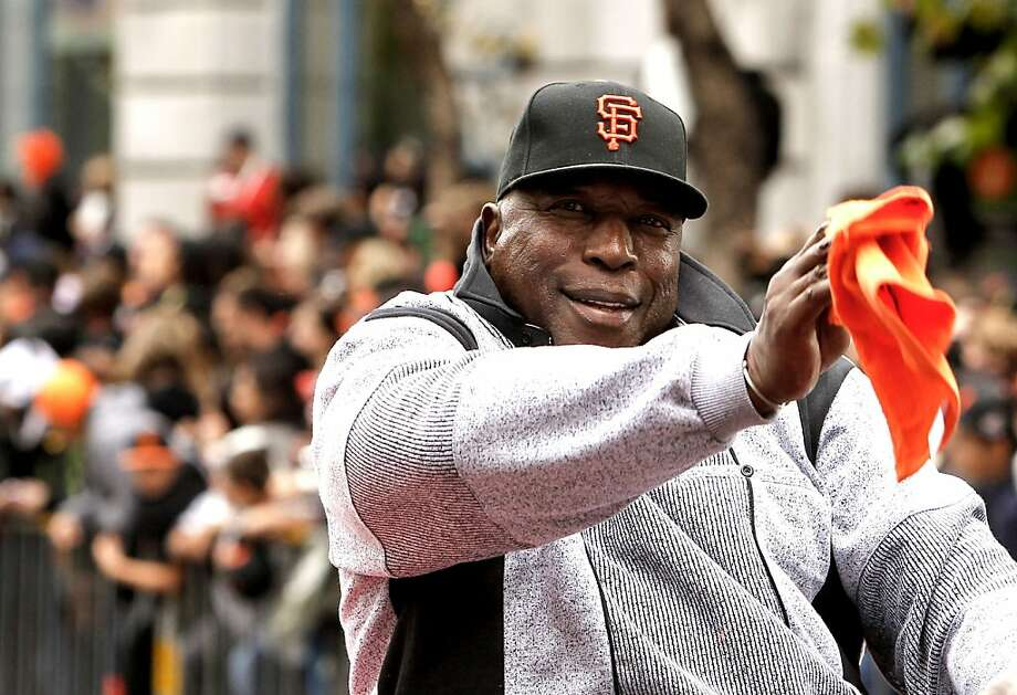 Giants' great Willie McCovey waves to fans as the San Francisco Giants celebrate their World Series Championship with a parade up Market Street in downtown San Francisco, Calif., on Wednesday Oct. 31, 2012. Photo: Michael Macor, The Chronicle
