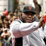 Giants' great Willie McCovey waves to fans as the San Francisco Giants celebrate their World Series Championship with a parade up Market Street in downtown San Francisco, Calif., on Wednesday Oct. 31, 2012.