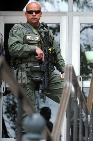 A Bridgeport Police Department SWAT Team stands guard in front of the Golden Hill Street courthouse, in Bridgeport, Conn. after a fight broke out during a muder arraignment on Wednesday, Oct. 31st, 2012. Photo: Ned Gerard, Connecticut Post / Connecticut Post
