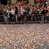 Confetti filled the streets as fans filled the sidewalks as the San Francisco Giants celebrated their World series Championship with a parade up Market Street in downtown San Francisco, Calif., on Wednesday Oct. 31, 2012.