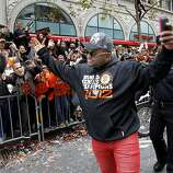 Pablo Sandoval departed from his parade automobile on Market Street to greet fans. The San Francisco Giants celebrated their second World Series title in three years with a parade down Market Street Wednesday October 31, 2012.