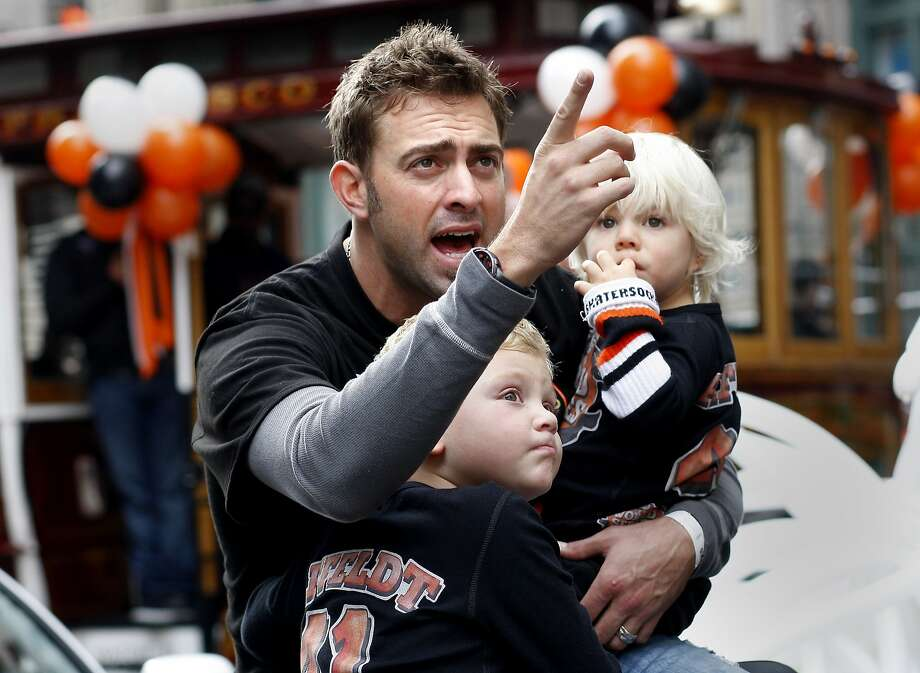 Jeremy Affeldt held his two children as he waited for the parade to begin. The San Francisco Giants celebrated their second World Series title in three years with a parade down Market Street Wednesday October 31, 2012. Photo: Brant Ward, The Chronicle