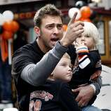 Jeremy Affeldt held his two children as he waited for the parade to begin. The San Francisco Giants celebrated their second World Series title in three years with a parade down Market Street Wednesday October 31, 2012.