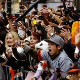 Fans filled the sidwalks as the San Francisco Giants celebrated their World Series Championship with a parade up Market Street in downtown San Francisco, Calif., on Wednesday Oct. 31, 2012.