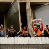 Fans filled window ledges as the San Francisco Giants celebrated their World Series Championship with a parade up Market Street in downtown San Francisco, Calif., on Wednesday Oct. 31, 2012.