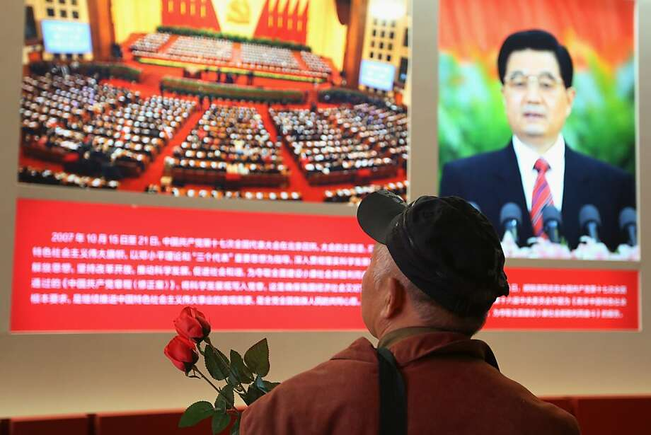 At the 18th National Congress of the Communist Party of China in Beijing, an exhibit on Chinese scientific achievements features an image of President Hu Jintao. Photo: Feng Li, Getty Images