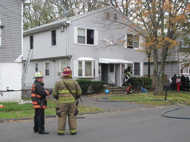 Stratford, Conn. firefighters quickly knocked down a fire in the second-floor bedroom of a house on Columbus Avenue on Oct. 31, 2012. Photo: Tom Cleary