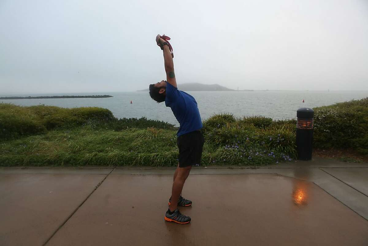 Rowan Jimenez stretching after a run on the bay front in Richmond, Calif., on Friday, October 19, 2012.
