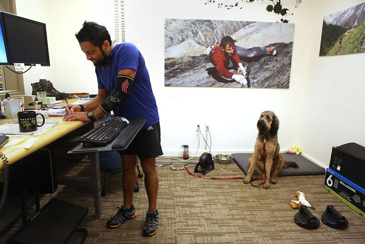 Rock star and warranty manager Rowan Jimenez at Montrail in his office after a morning run with his dog Babka in Richmond, Calif., on Friday, October 19, 2012.