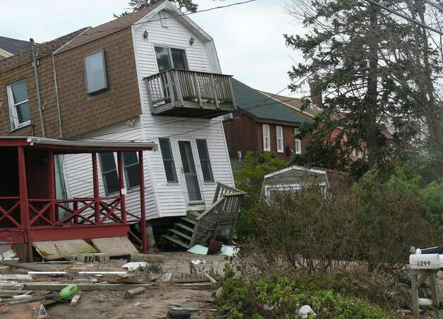 A home on Fairfield Beach Road is left leaning after Sandy. Photo: Genevieve Reilly