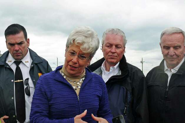 At a press conference Wednesday on the banks of Pine Creek, from left, Police Chief Gary MacNamara, Lt. Gov. Nancy Wyman, First Selectman Mike Tetreau and Fire Chief Richard Felner. Photo: Genevieve Reilly