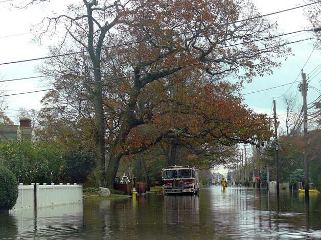 Water still remained high on Reef Road near Veterans Park Wednesday afternoon. Photo: Genevieve Reilly