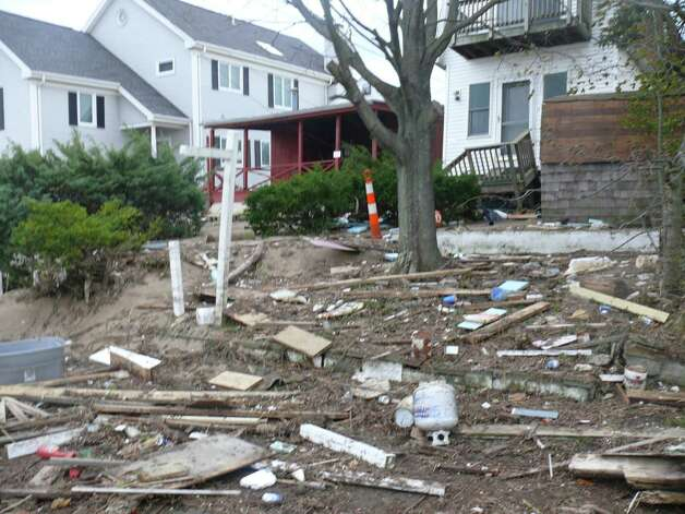 Sandy's calling card was still evident on Fairfield Beach Road Wednesday afternoon. Photo: Genevieve Reilly