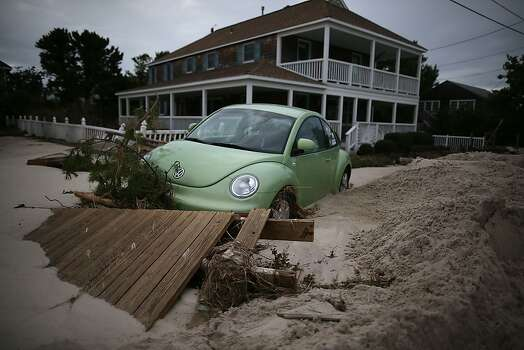 31:  A car is submerged in sand and debris washed in from Hurricane Sandy, on October 31, 2012 in Long Beach Island, New Jersey. Earlier in the week Hurricane Sandy made landfall on New Jersey coastline bringing heavy winds and record floodwaters.  (Photo by Mark Wilson/Getty Images) Photo: Mark Wilson, Getty Images