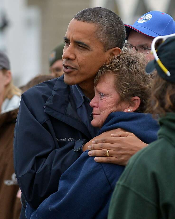 President Obama comforts storm victim Dana Vanzant in Brigantine, N.J. Photo: Jewel Samad, AFP/Getty Images