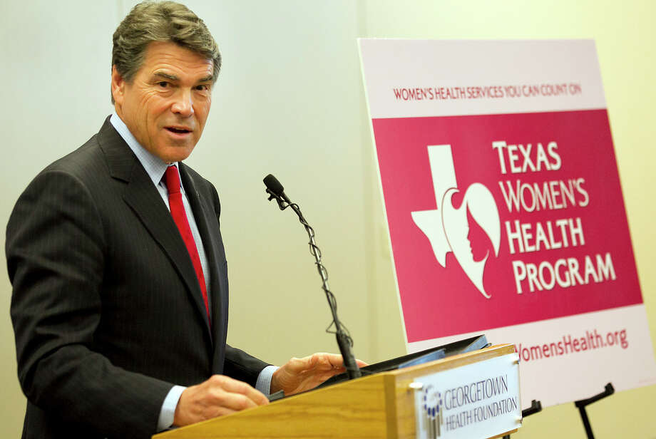 Texas Gov. Rick Perry and Texas Health and Human Services Commissioner Kyle Janek announce  at a press conference at the Lone Star Circle of Care center in Georgetown, Texas, Wednesday Oct. 31, 2012, that the state-funded Texas Women's Health Program is ready to begin providing preventative health services to low-income Texas women.(AP Photo/American-Statesman, Ralph Barrera) Photo: Ralph Barrera, Associated Press / American-Statesman