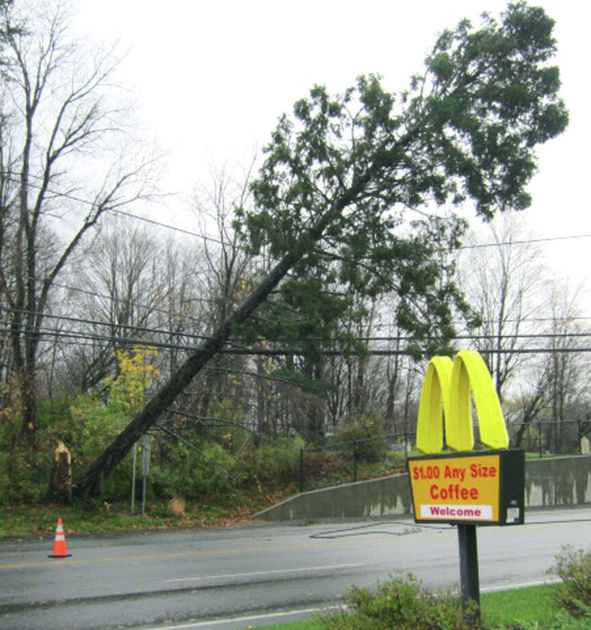 A fallen tree on live wires across Danbury Road (Route 7 South) in New Milford forced closure early Tuesday morning of the town's major traffic artery from Sunny Valley Road to Pickett District Road. Traffic was being detoured around Sunny Valley Road for points both north and aouth. Oct. 30, 2012 Photo: Norm Cummings
