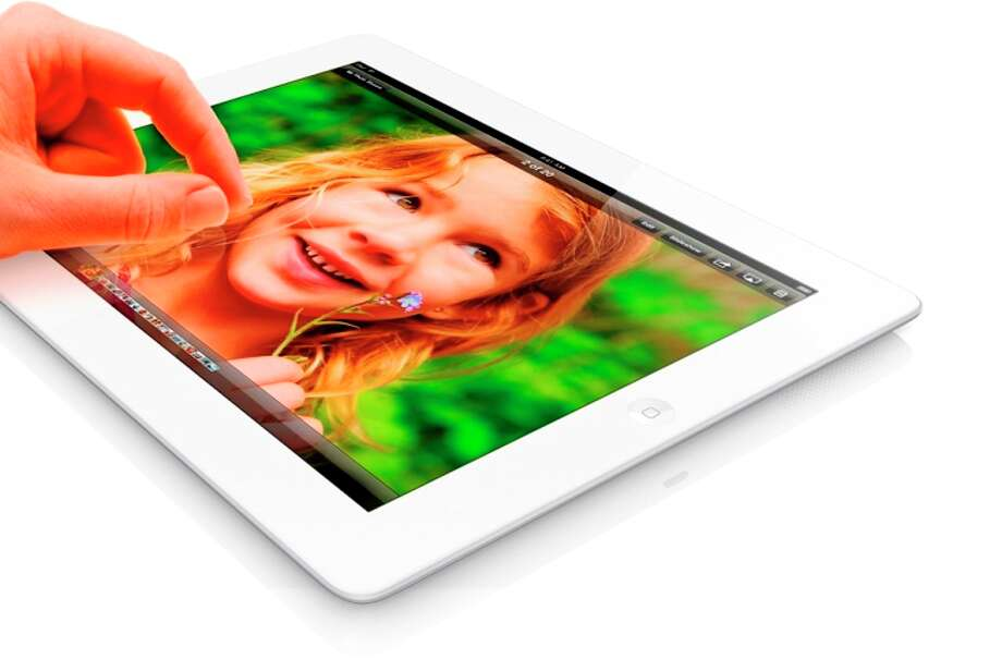 iPad with retina displayApple9.7-inch touch screen2048x1536 resolution 9.5 x 7.31 x 0.37 inchesLess than 1.5 poundsBattery life up to 10 hours16GB to 64GB A6X chip with quad-core  graphicsiOS operating  system2 cameras SiriNew Lightning connectorStarting at $499 for Wi-Fi  modelStarting at $629 for Wi-Fi plus 4G model  Available Friday (Courtesy Apple)