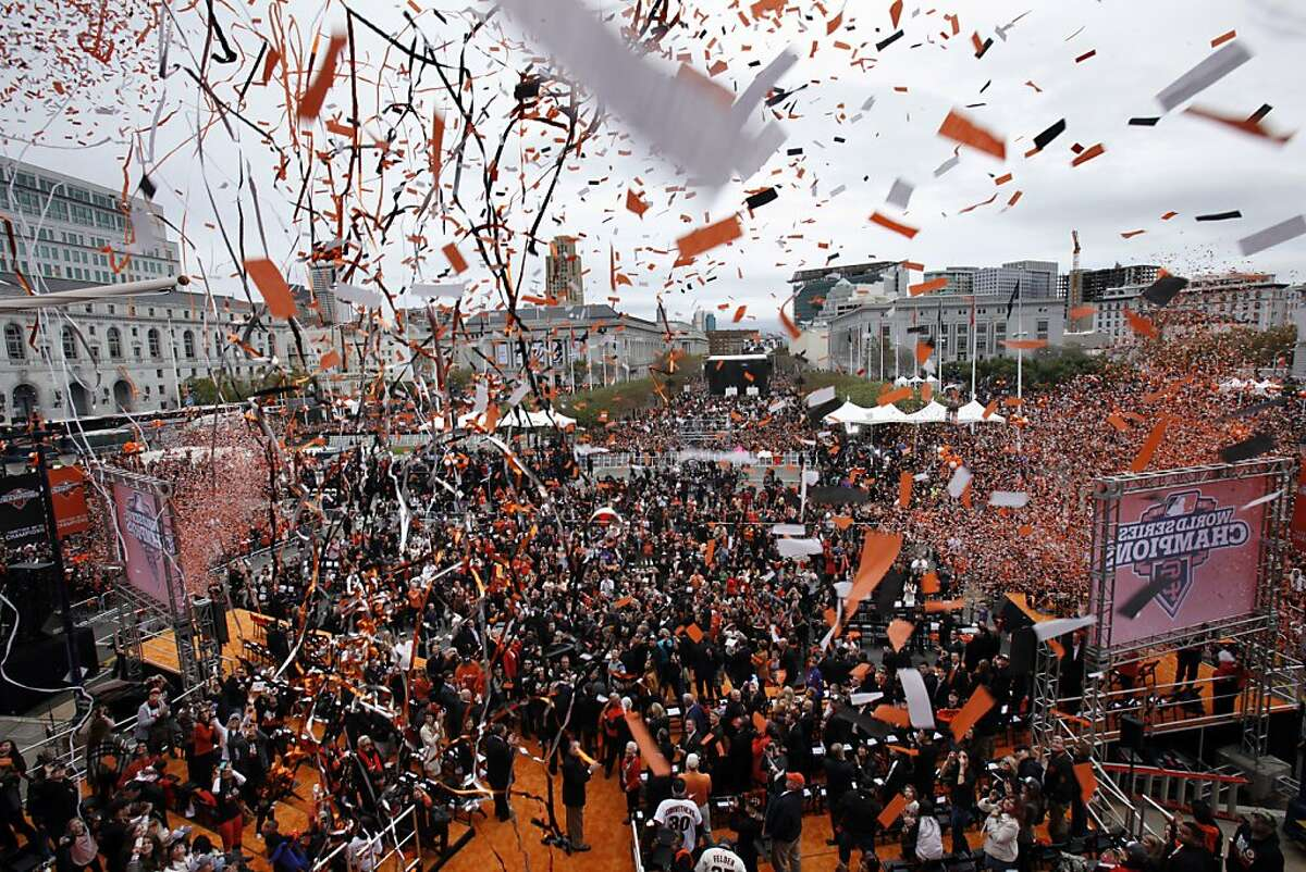 Confetti and streamers cascade down from City Hall as the city of San Francisco celebrated the Giants victory as World Series Champions with a parade and ceremony at Civic Center Plaza on Wednesday, October 31, 2012.