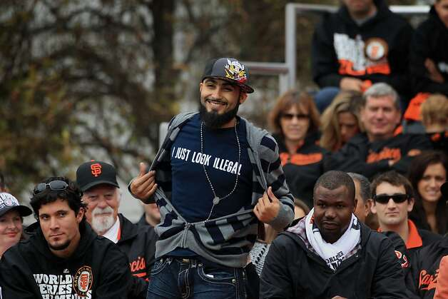 San Francisco Giants pitcher Sergio Romo greets the fans as he is introduced  to the crowd during the World Series victory celebration, Wednesday Oct. 31, 201, in San Francisco, Calif. Photo: Lacy Atkins, The Chronicle