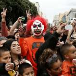 A costumed fan celebrates during the World Series victory parade on Wednesday, October 31, 2012 in San Francisco, Calif.