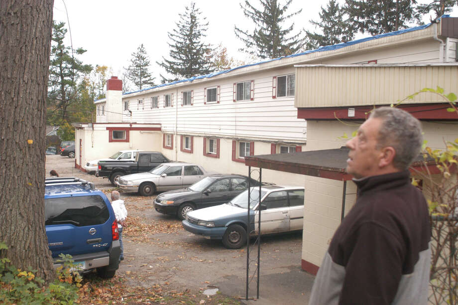 Joao DeLima, building manager at 9 Beaver Brook Road in Danbury, stands outside the apartment building that was condemned by the city Wednesday as a result of the damage from storm Sandy, leaving more than 30 people homeless. Photographed on Wednesday, Oct. 31, 2012. Photo: John Pirro