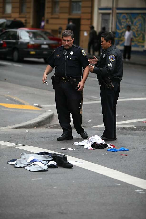 Officers discuss evidence, including the victim's clothes, at the scene of a shooting on Leavenworth and Turk on October 31, 2012 in San Francisco, Calif. Photo: Pete Kiehart, The Chronicle