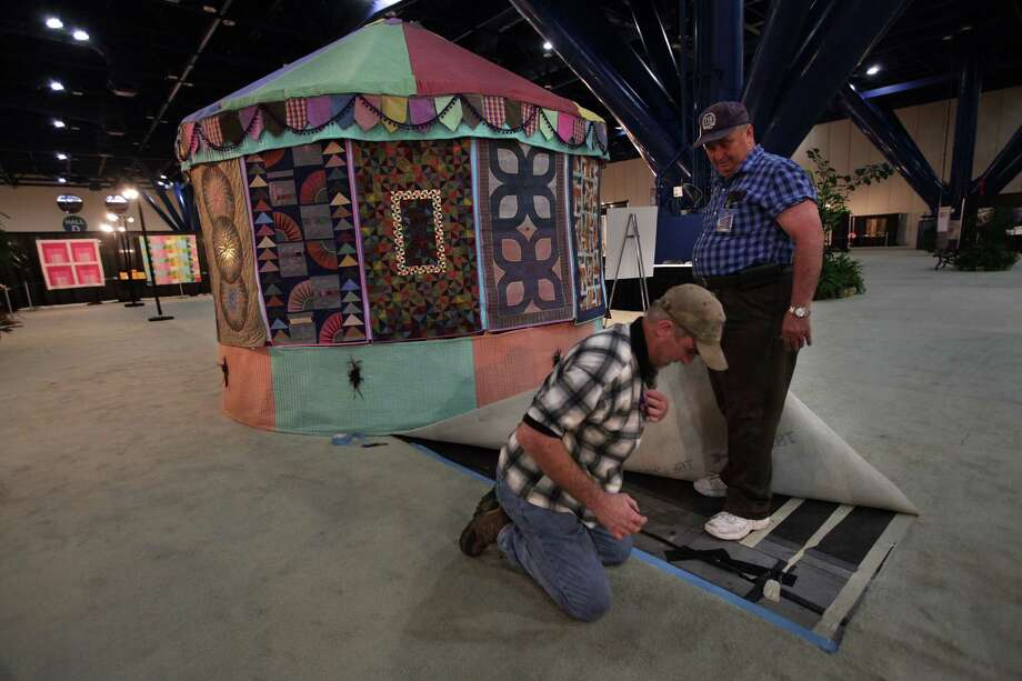 Convention staff George Hanley and Dan Castleberry fix electricity issues in preparations for the International Quilt Festival at the George R. Brown Convention Center on Wednesday, Oct. 31, 2012, in Houston. Photo: Mayra Beltran, Houston Chronicle / © 2012 Houston Chronicle