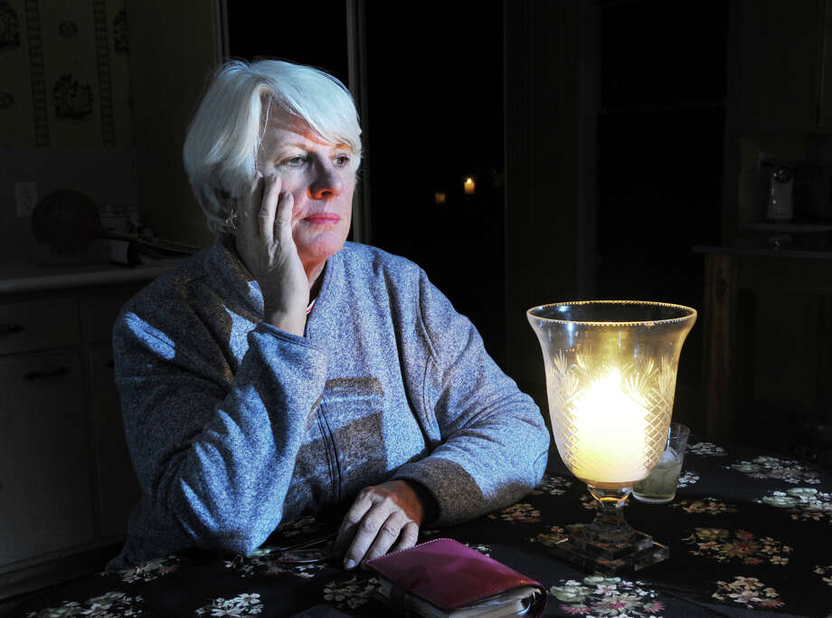 "Sitting at her Kitchen table by candle light, Old Greenwich resident Karen Sadik-Khan said ""we were the lucky ones,"" Wednesday Night, Oct. 31, 2012, reflecting on the devastation wrought by Hurricane Sandy to her neighbors on Binney Lane where three homes were destroyed by fire. Photo: Bob Luckey / Greenwich Time"