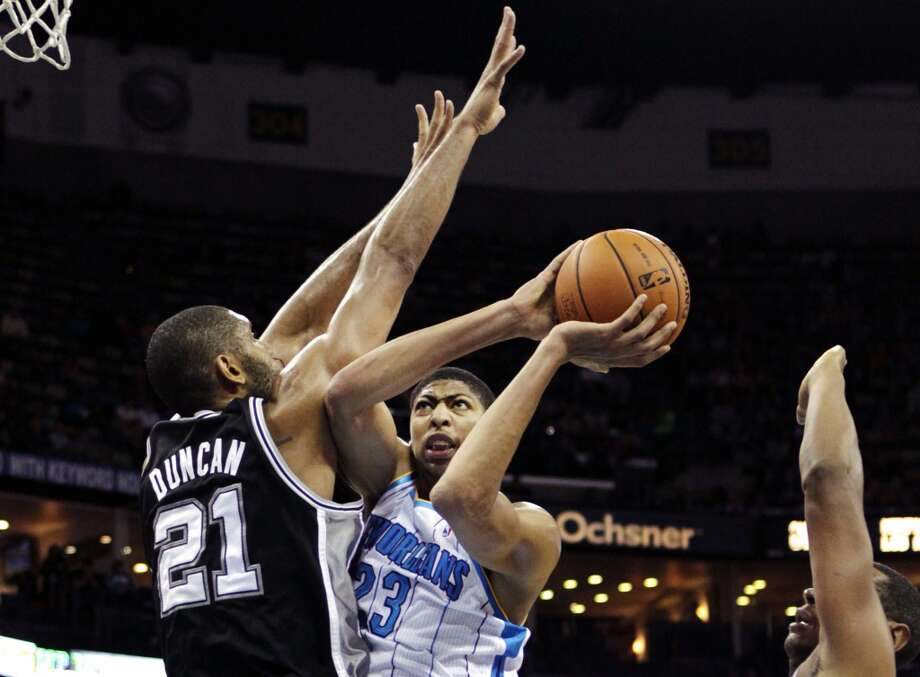 New Orleans Hornets power forward Anthony Davis (23) drives to the basket against San Antonio Spurs power forward Tim Duncan (21) in the first half of an NBA basketball game in New Orleans, Wednesday, Oct. 31, 2012. (AP Photo/Gerald Herbert) (Associated Press)